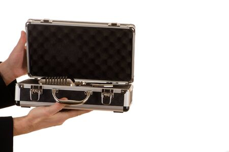 hands of the man open metal case with microphone