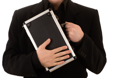 man in a black jacket and a black shirt with metal case Banco de Imagens