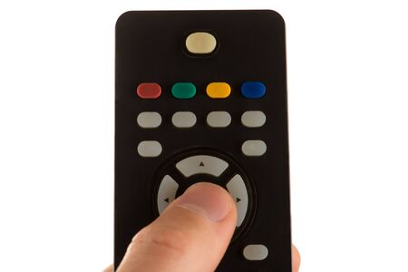 hand holds the panel of the TV and the finger presses the button