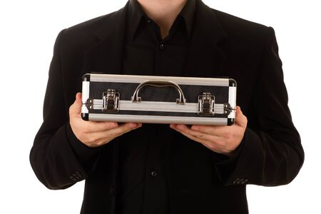 man keeps a metal case in a black horizontally Banco de Imagens