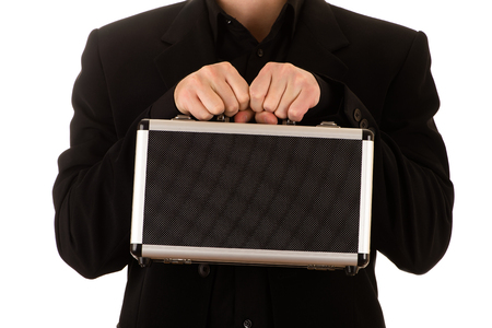 the case before: man strong keeps in a black before himself a metal case
