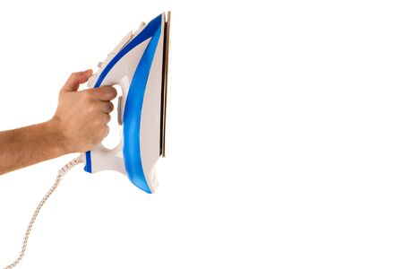 hand holds the white iron with blue strips Banco de Imagens