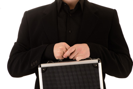 the case before: man keeps in a black before himself a metal case Stock Photo