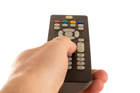 hand of the man holds the panel of the TV and the finger changes channels Banco de Imagens