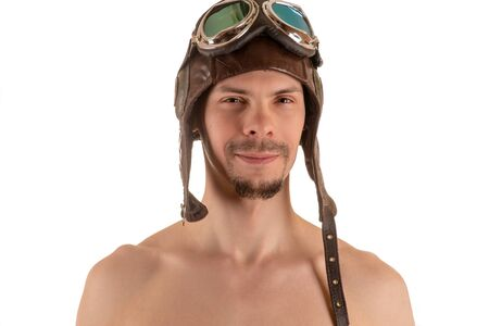 flight helmet: portrait of smiling man with narrowed eyes looking at camera in flight helmet and flying goggles Stock Photo