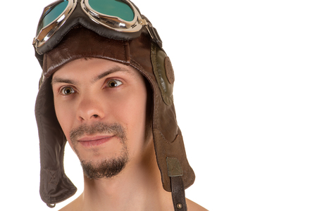 flight helmet: portrait of smiling man with mad look in flight flying helmet and goggles