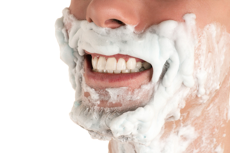 lower part of face in shaving foam Caucasian man with beard grinning teeth