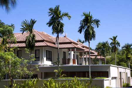Beautiful white villa with palm trees and a garden, Thailand