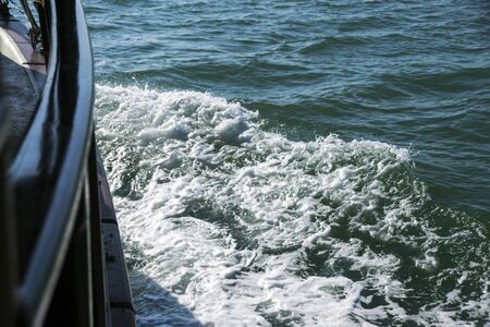 View from the side of a wooden ship on the ocean waves