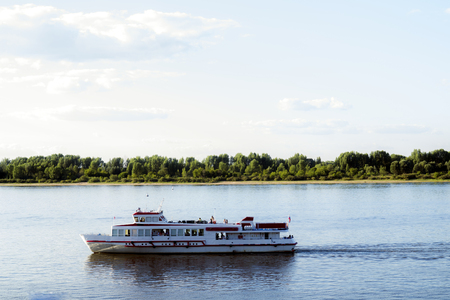 Pleasure boat floats on the river
