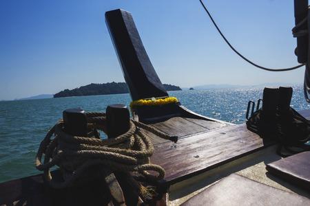Bow of wooden ship going across the sea to the island Banco de Imagens