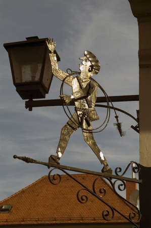 metall lamp: old sign for chimney-sweeper in the street, central Europe