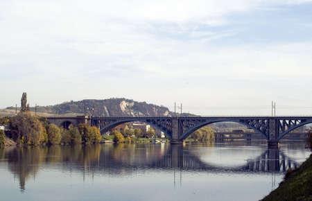 Long railway bridge over river in daytime photo