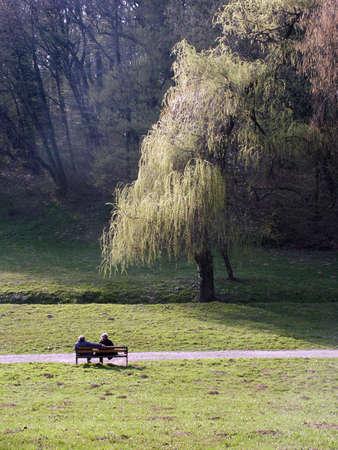 Couple seat on the nice spring sun