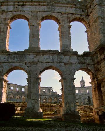croatian: Old roman colosseum in croatian city of Pula, Adriatic coastline