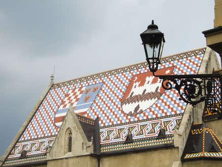 zagreb: Old classic metallic lantern and roof with croatian insingnia in Zagreb
