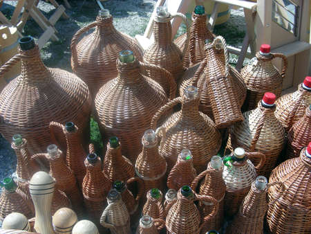 demijohn: New home made cane bottles at the market place