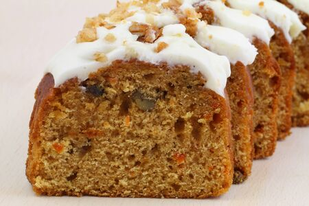Carrot and walnut cake with marzipan icing, close up photo