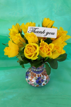 thanking: Thank you note and yellow roses