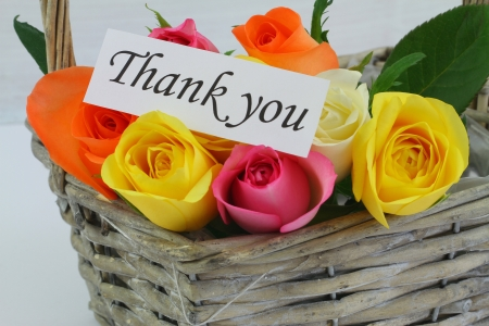 Thank you note with colorful roses in wicker basket photo