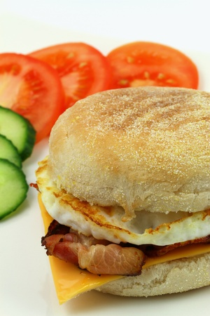 English muffin with bacon, egg and Cheddar cheese photo