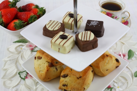 afternoon tea: Cake tray with scones and chocolates Stock Photo