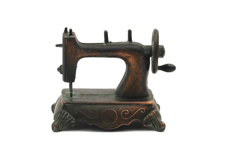 Brass vintage pencil sharpener in shape of sewing machine photo