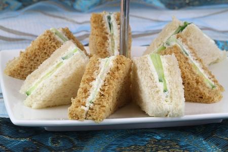 english cucumber: English cream cheese and cucumber sandwiches Stock Photo