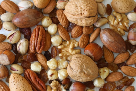 Selection of nuts, almonds and sultanas, close up photo
