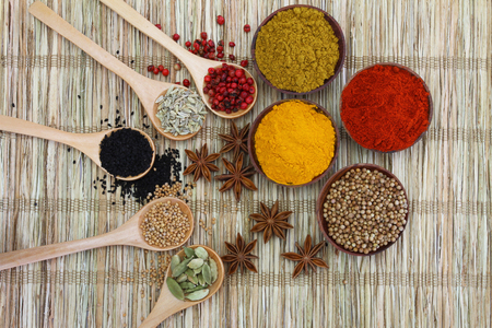 Selection of Indian spices on bamboo mat photo