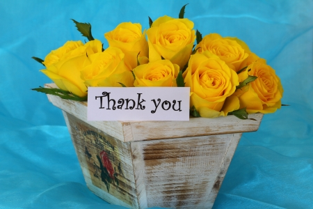 thank you note: Thank you note with yellow roses in vintage wooden flower box on blue background Stock Photo