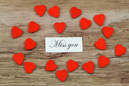 Miss you card with little red wooden hearts photo
