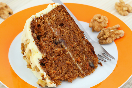 walnut cake: Carrot and walnut cake with marzipan icing, close up Stock Photo