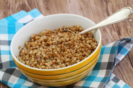Bowl of cooked buckwheat, close up