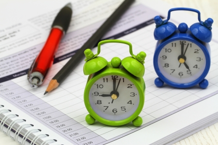 pm: Miniature clocks showing 9 am and 5 pm on open agenda