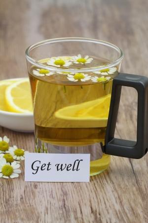 Get well note, chamomile tea and fresh lemon photo