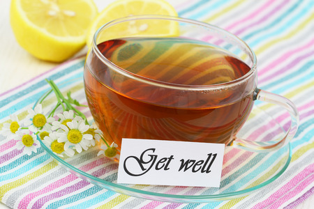 Get well card with fresh chamomile flowers and lemon photo