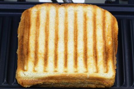 toasted sandwich: Toasted sandwich in toaster, close up