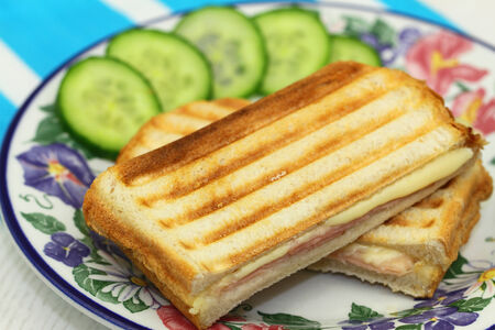 toasted sandwich: Toasted sandwich with ham and cheese