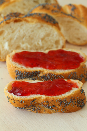 Challah slices with strawberry jam photo