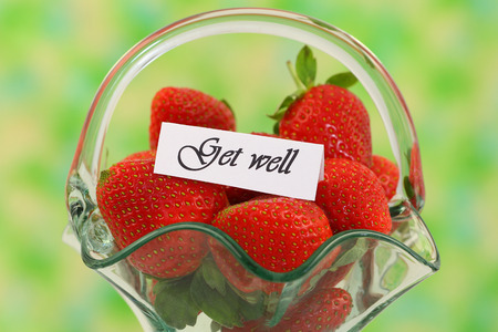get well: Get well card with fresh strawberries in vintage glass basket Stock Photo