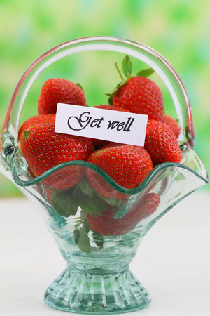 Get well card with fresh strawberries in vintage glass basket photo