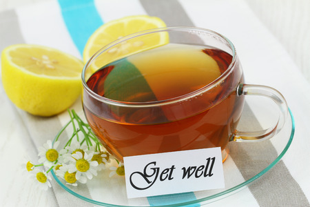 Get well card with cup of chamomile tea and lemon photo
