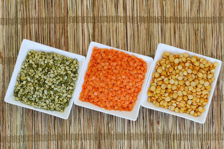 pulses: Selection of pulses in white bowls with copy space