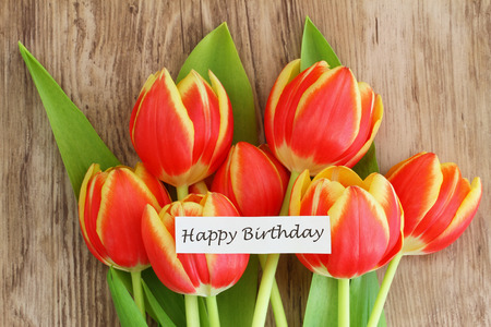 Happy Birthday card with red and yellow tulips photo