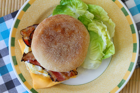 English muffin with fried egg, bacon and cheese photo