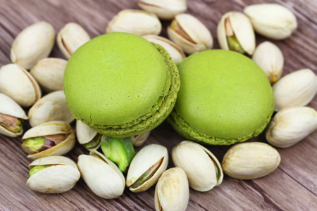 Pistachio macaroons on pistachio nuts photo