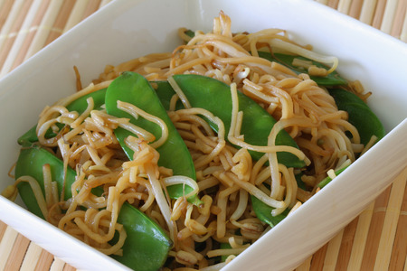 beansprouts: Bowl of egg noodles stir fried with snow peas and beansprouts Stock Photo