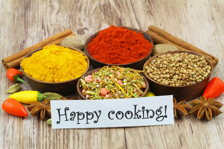 Happy cooking card with selection of spices and chilies photo