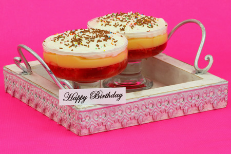 trifles: Happy birthday card with strawberry trifles on wooden tray with pink background